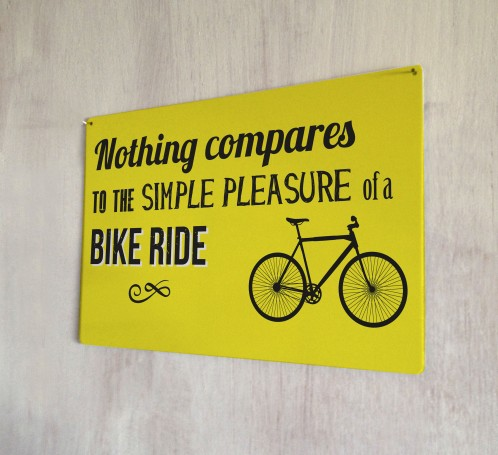 Simple pleasure of a bike ride metal sign