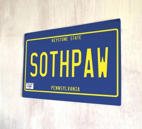 Southpaw number plate metal sign